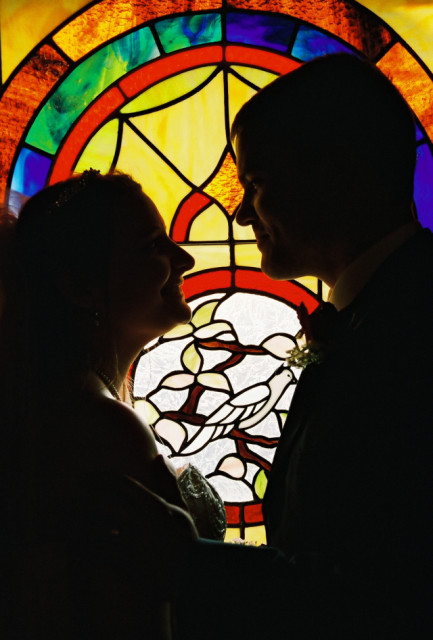 Wife, groom, stained glass background.